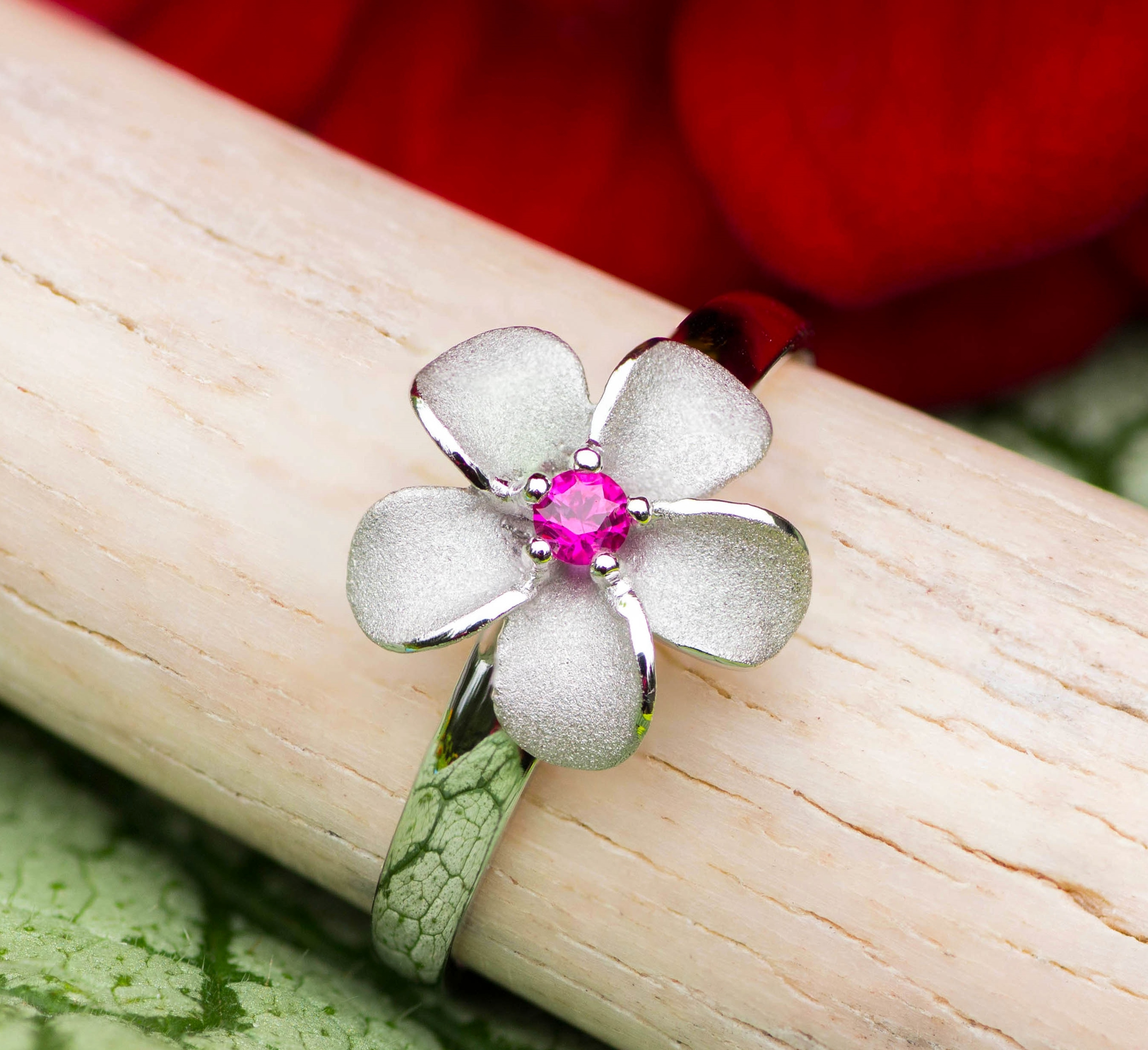 Forget Me Not Flower Ring in White Gold with a Ruby center