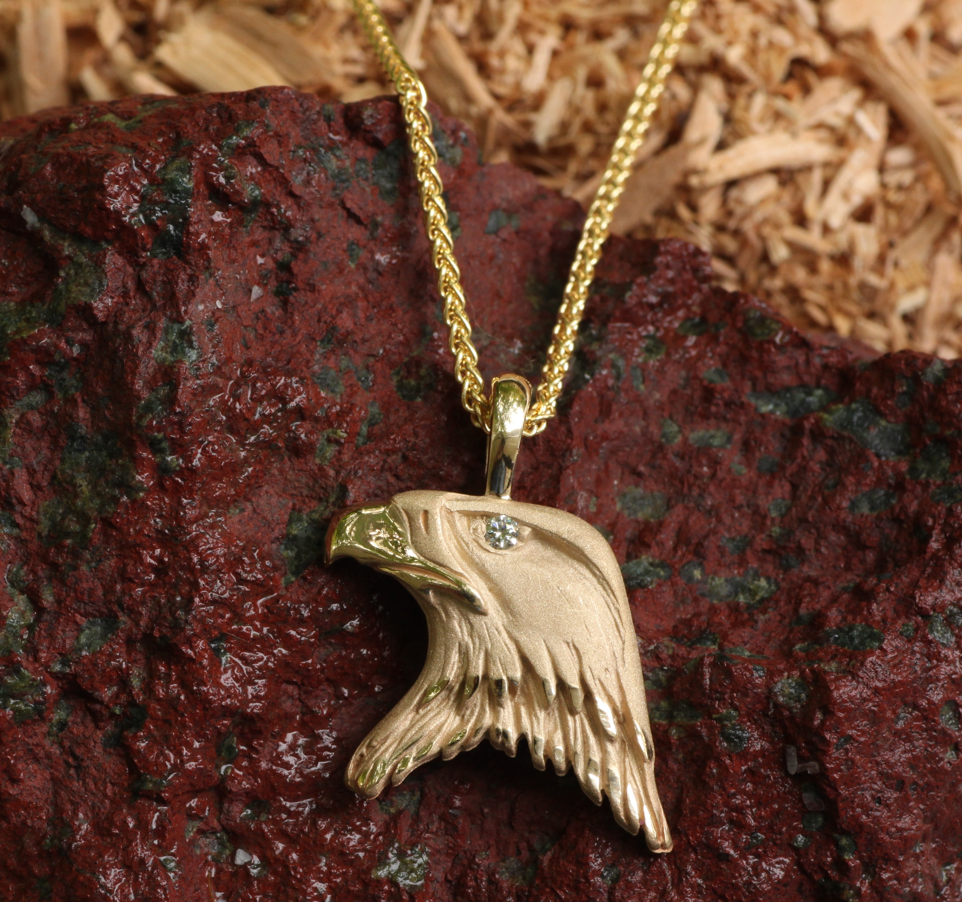 Wild Bald Eagle Pendant in 14 kt yellow gold with a Diamond