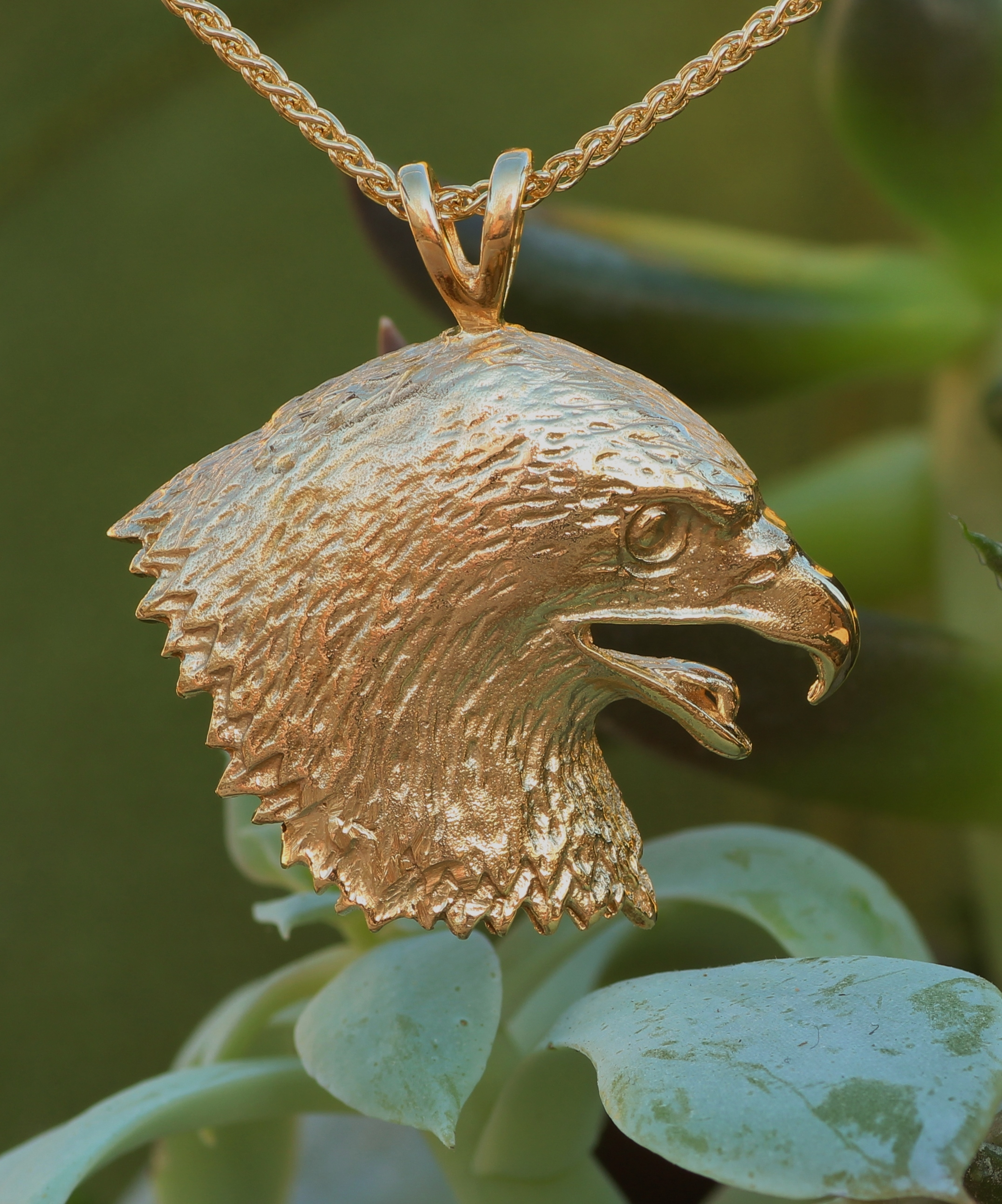 Wild Eagle Pendant in 14 kt yellow gold.