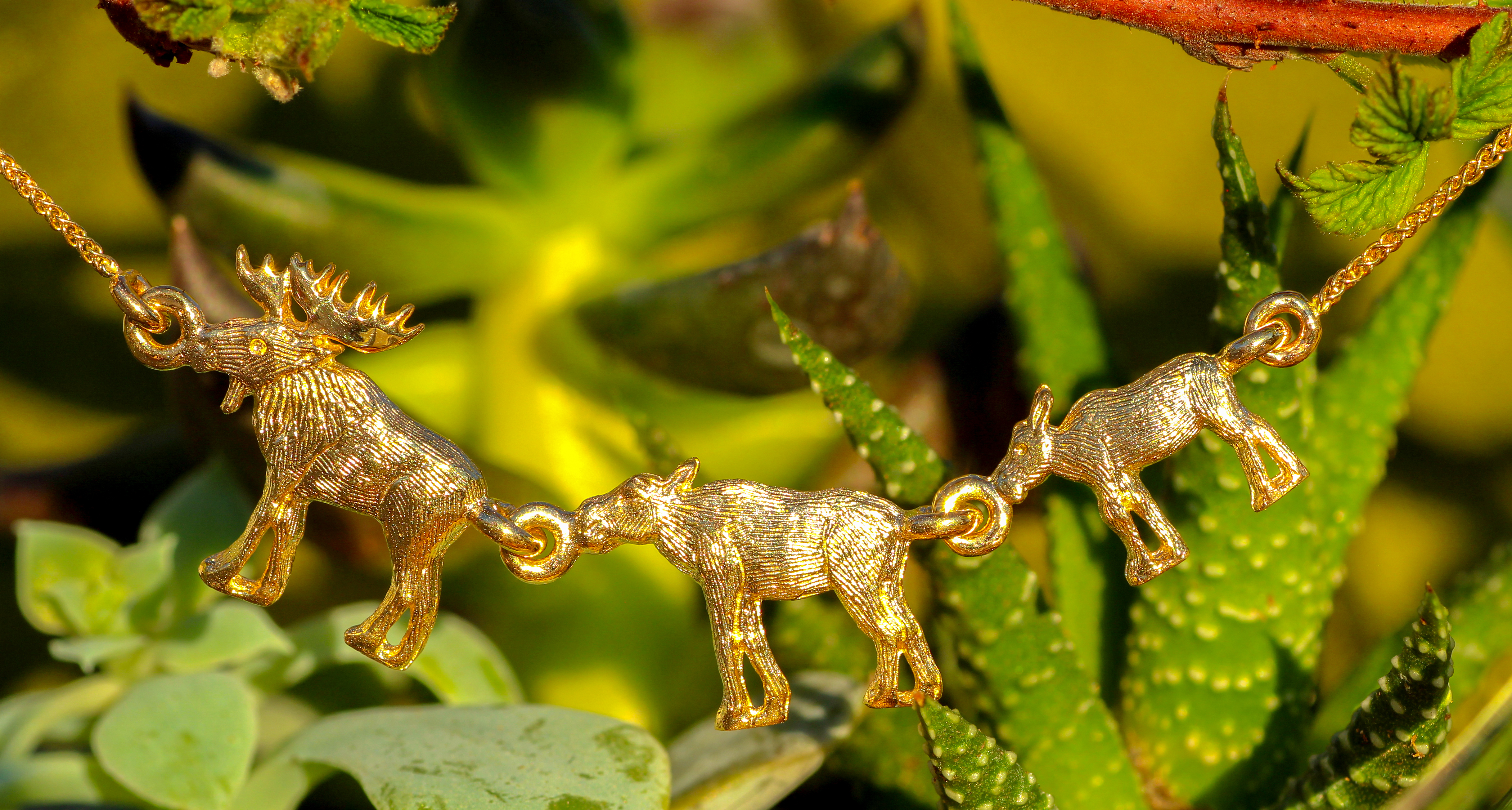 Moose Family Necklace in 14Kt Yellow Gold pendant.