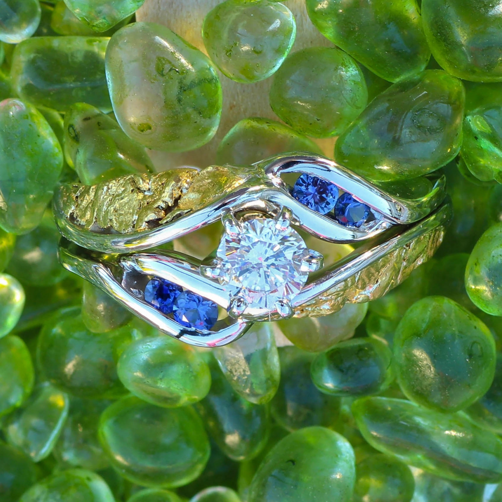 Stunning diamond center stone surrounded with gorgeous Alaskan gold nuggets and Sapphires in 14kt white gold.