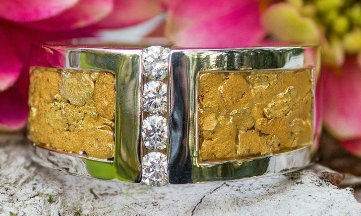 Custom Alaskan Gold Nuggets and 4 brilliant Diamonds channel-set in 14kt White Gold wedding band.
