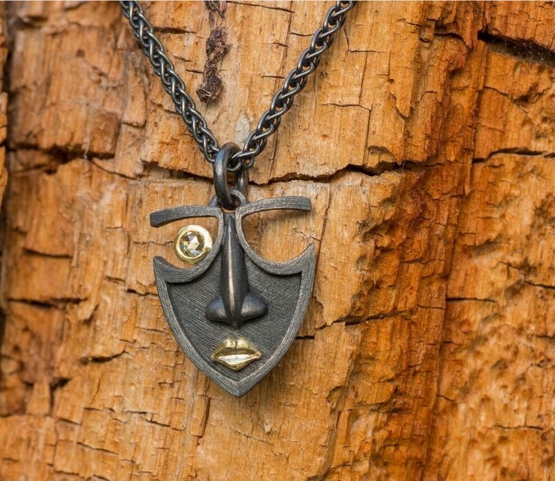 Mask Pendant in oxidized sterling silver and 18kt yellow gold