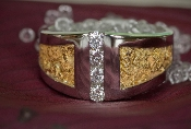 Custom Alaskan Gold Nuggets and 4 brilliant Diamonds channel set in a 14kt White Gold wedding band.