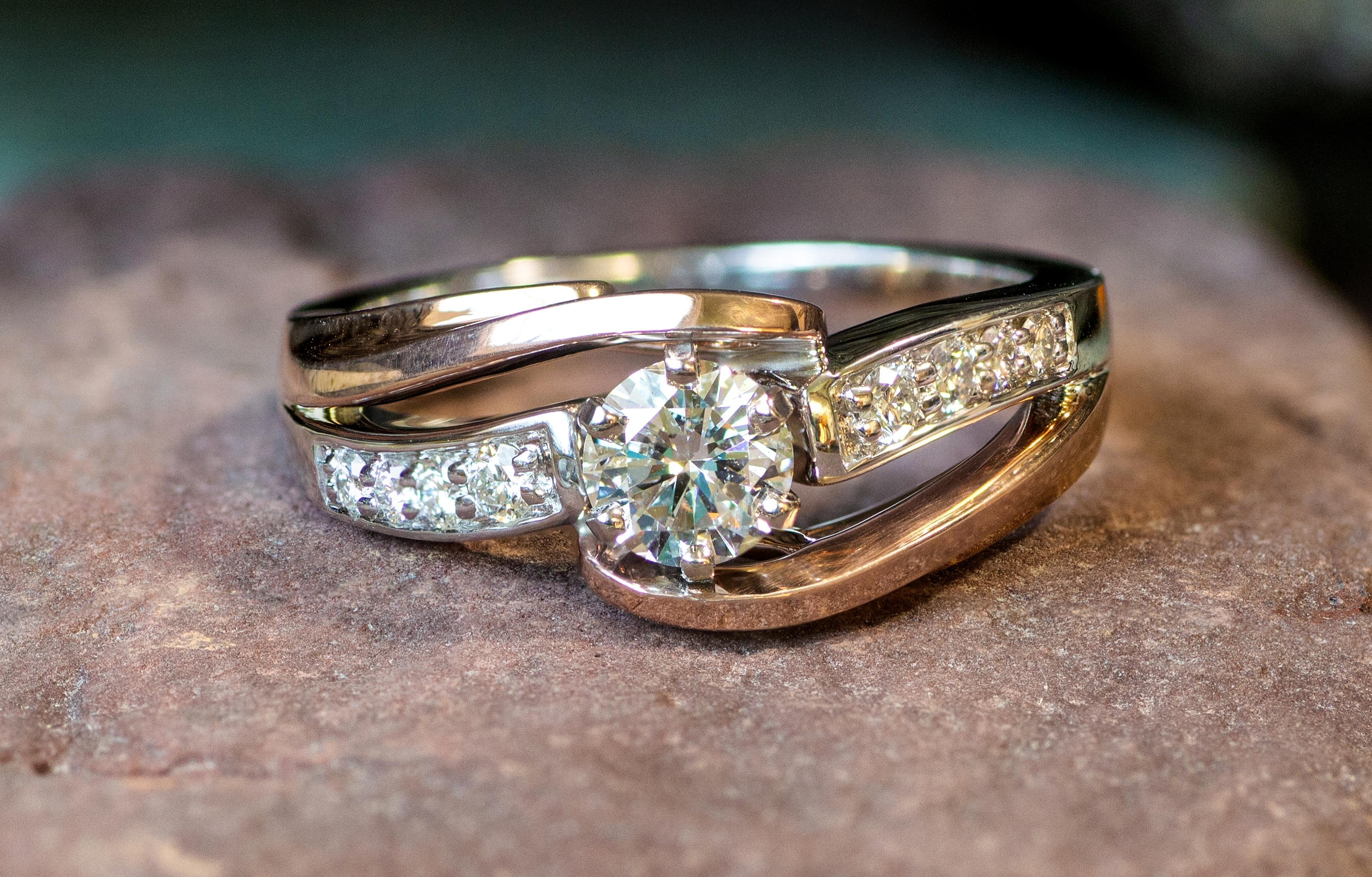 Diamonds in 14kt White and Rose Gold wedding ring.