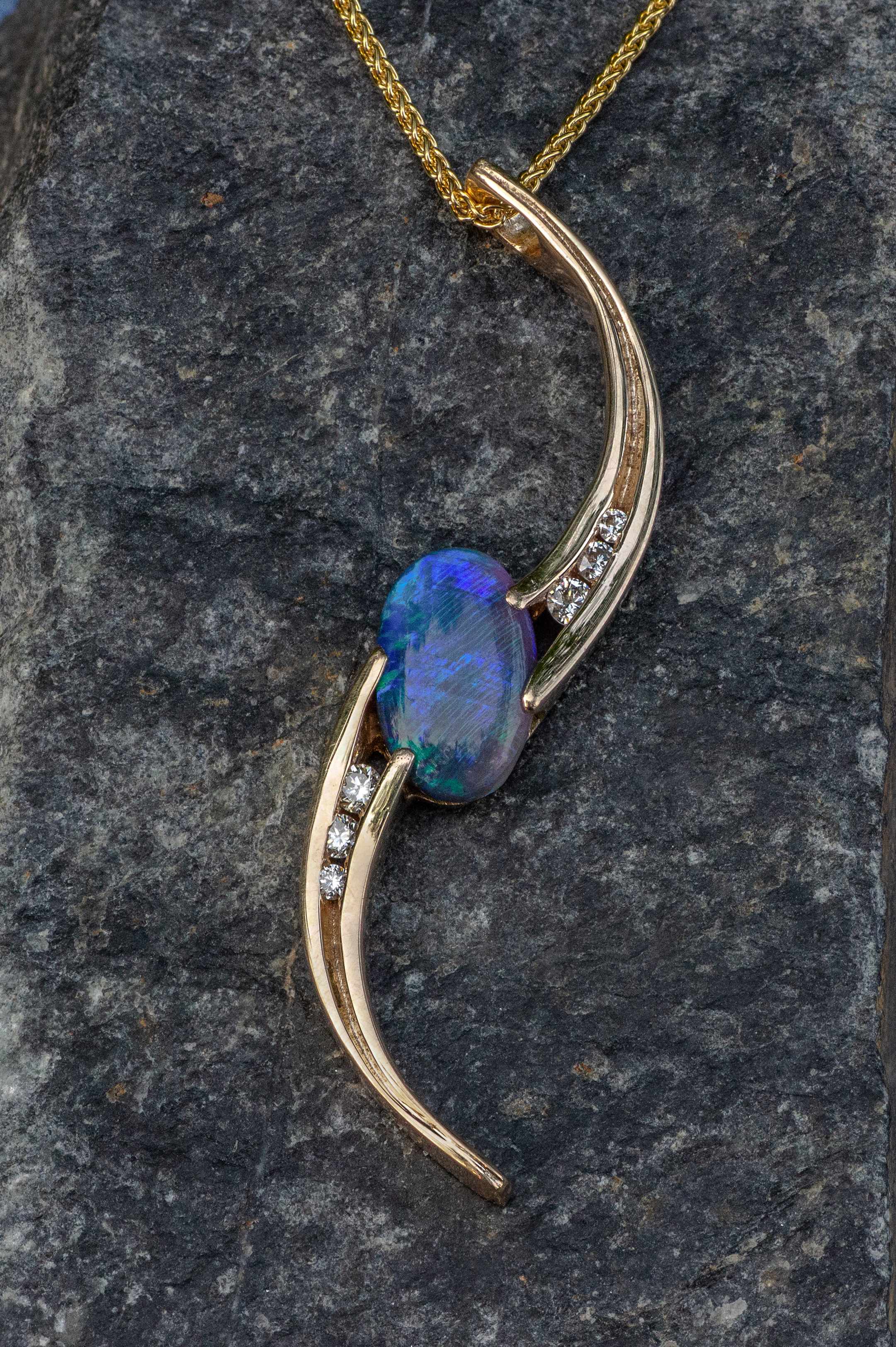 Opal and Diamond pendant in 14kt yellow gold