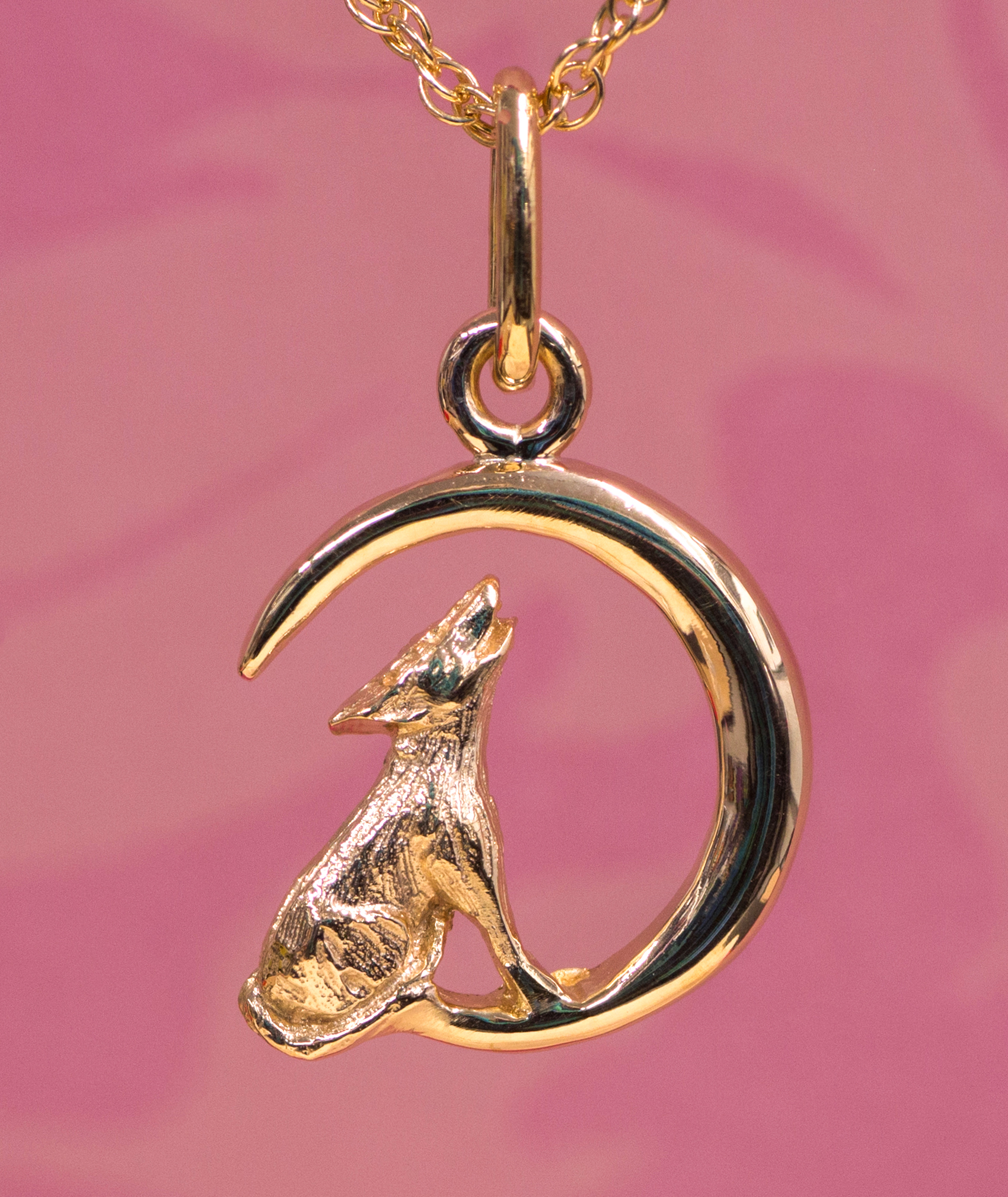 Wild Alaska Howling Wolf Pendant Crafted in 14kt Yellow Gold.