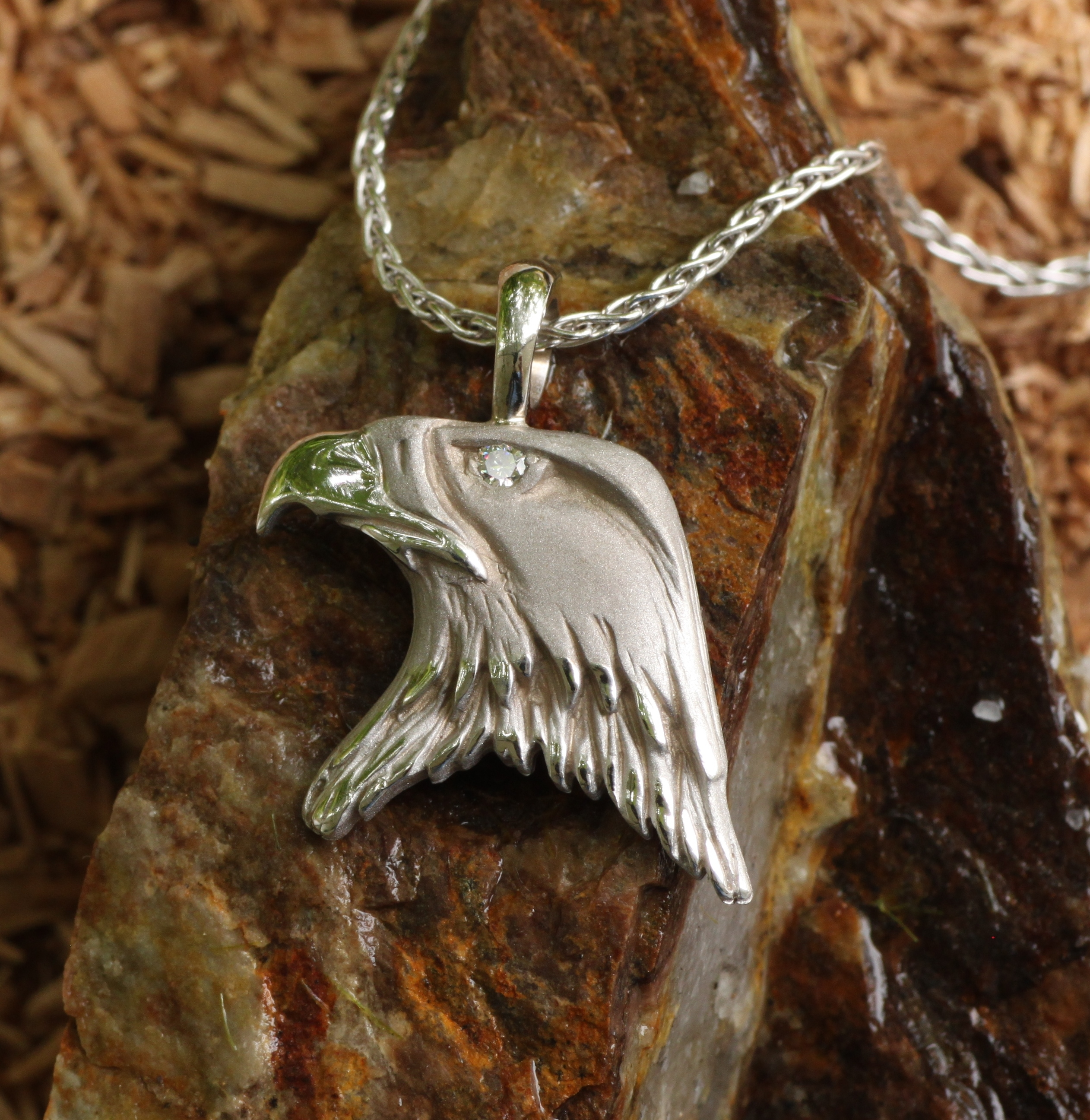 Wild Bald Eagle Pendant in 14 kt white gold with a Diamond