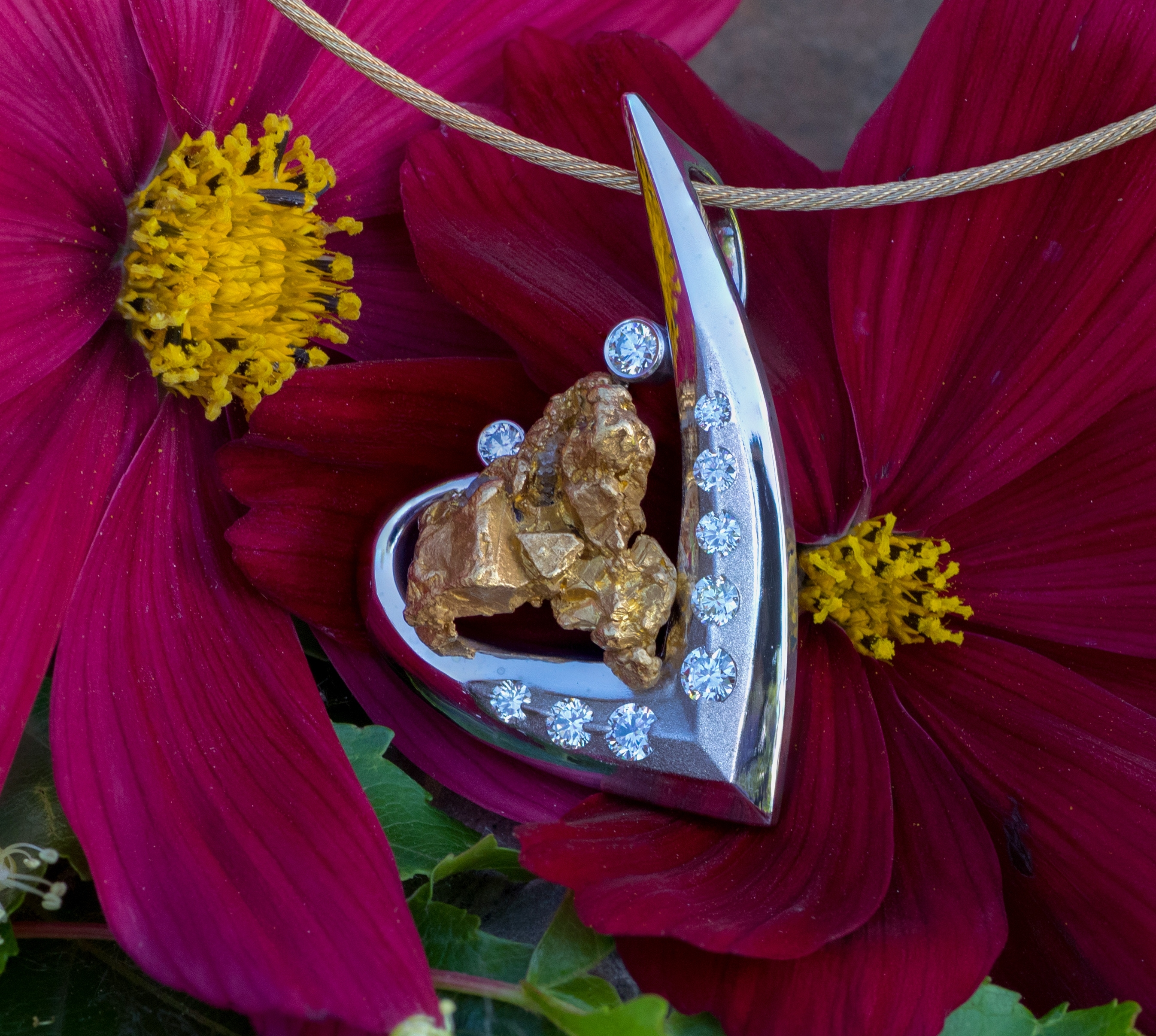 Alaskan Gold Nugget pendant and diamonds in 14kt white gold.