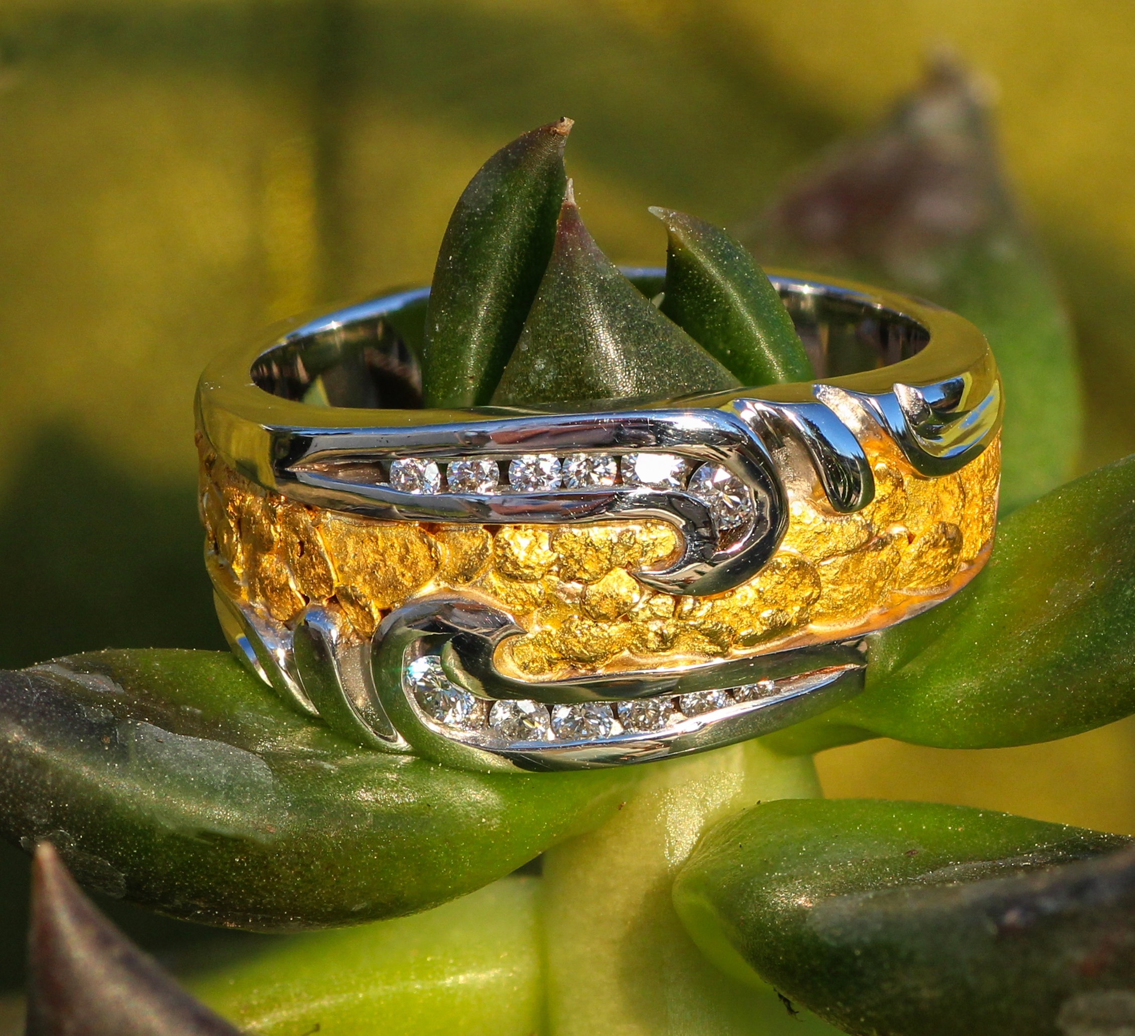 Alaskan Gold Nuggets and brilliant Diamonds channel-set in 14kt White Gold wedding band.